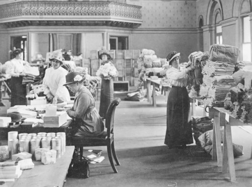 Volunteers at Federal Government House in St Kilda Road, Melbourne in 1916, the location of State Headquarters of Red Cross for some of the war years. The women are packing items to be sent in parcels to troops at the front. Courtesy Australian War Memorial, ID J00346.